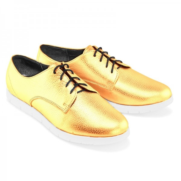 Женские спортивные туфли золотые